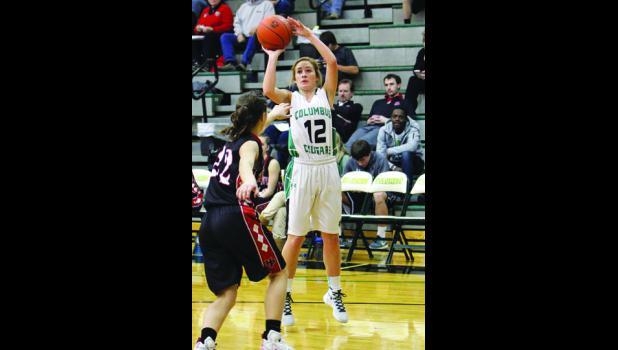 Columbus Cougar senior Kenedy Wiggs shoots over Red Devil freshman Lauren Sedgwick.