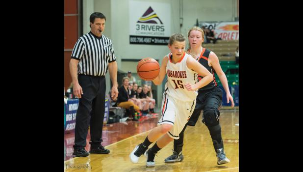 Husky junior Erin Campbell drives around a defender in the Wildcat game.