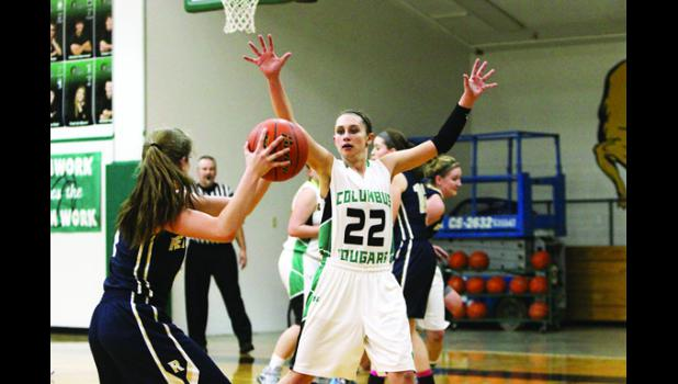 Cougar senior Carli Dyba defends against the Red Lodge Rams at home on Feb. 12.