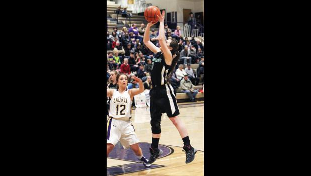 Cougar senior Desirae Gibson shoots over a Locomotive defender in the game in Laurel on Jan. 22.