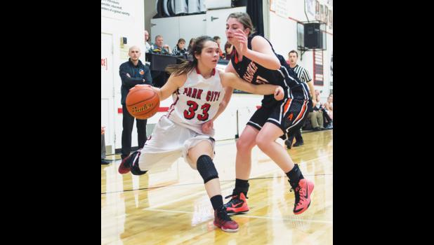 Park City Panther senior Hailee Gregerson drives around Husky senior Colleen Culbertson in Park City on Jan. 29.