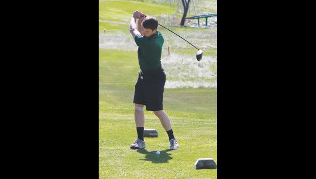 A Cougar golfer tees off on Saturday.