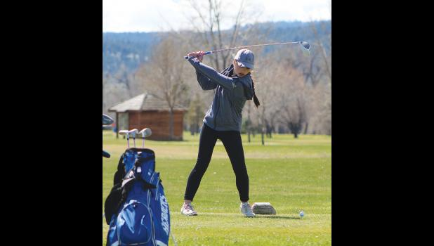 Lady Cougar Karsen Marjerison tees off at the 10th hole.