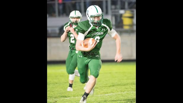 Columbus senior Chuck Miller takes takes off downfield in the Oct. 7 game against the J-Hawks in Joliet.