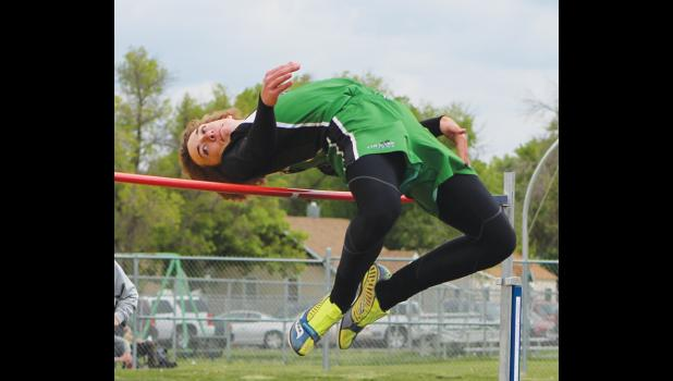 Cougar Dylan Sutton competes in high jump.  He qualified for state with a jump of 5-10.
