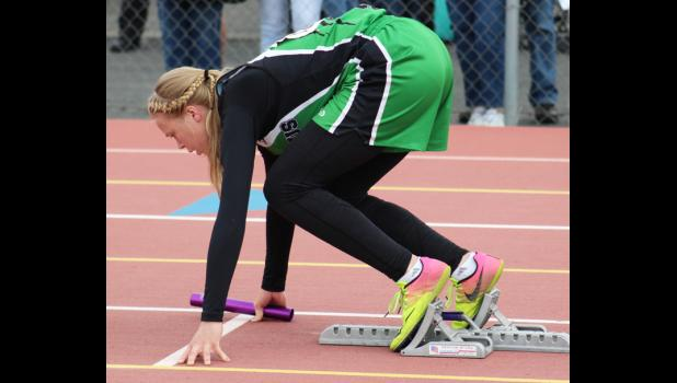 Cougar Liz Lorash waits for the gun in the blocks before the first leg of the 400-meter relay.  The Columbus team placed 12th, with a time of 52.88.