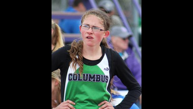 Amber LeBrun looks at the scoreboard after a race at state.