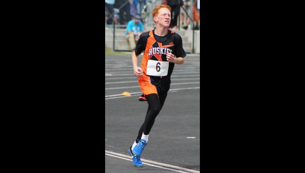 Jake Branger, of Absarokee, runs in the 3,200-meter race.  Branger finished with a time of 11:11.21.