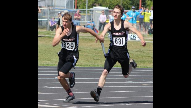 Panther Connor McNeil hands off the baton to Rylan Gauthier in the short relay.  The Park City team finished in fourth place with a time of 45.64.