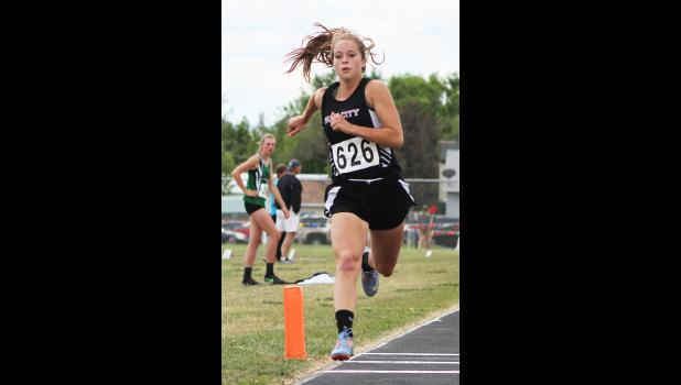 Park City's MacKinzie Verke competes in triple jump.  She finished in third with a jump of 34-06.25.