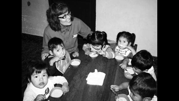 Lisa Forseth feeding orphans in Bolivia.
