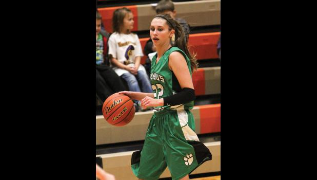 Columbus senior Carli Dyba brings the ball down the court in the game against the Trojans.