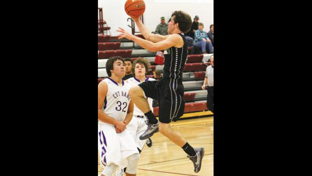Columbus senior Kiefer McKay lays up the ball for two points against the Cut Bank Wolves.