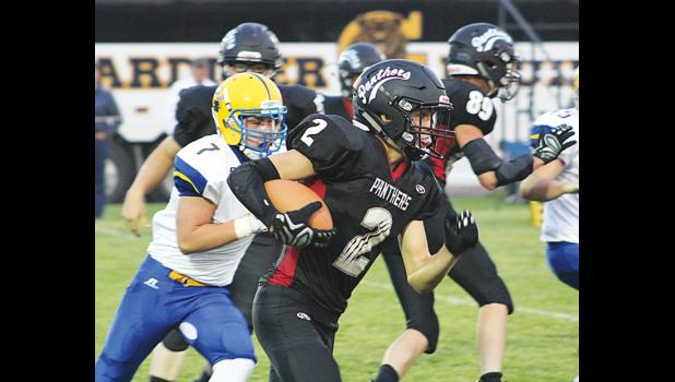 Sophomore Carson Baker takes off with the ball last Friday.  He ended the game with 148 yards rushing and four touchdowns.