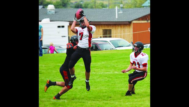 Park City Panther Devon Dennis grabs an interception in last weekend's 36-30 win over the White Sulphur Springs Hornets.