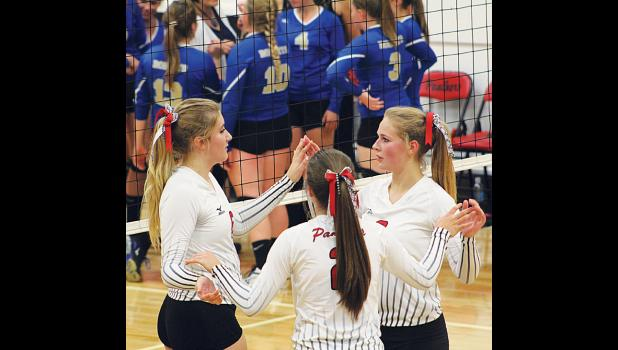 Alyx Grabowska, Hayley Story, and Kassidy Robbins prepare for a game to begin.