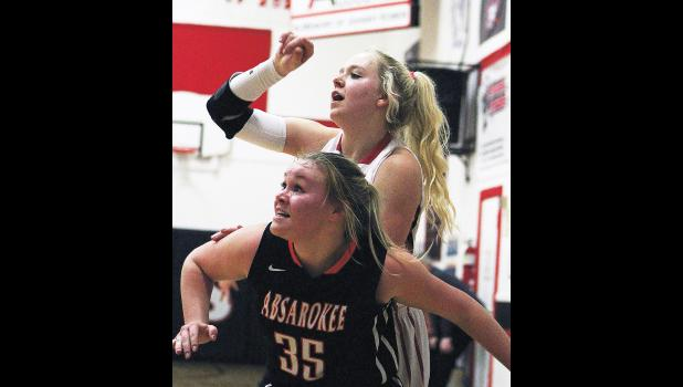Park City junior Blakely Verke watches her shot as Absarokee senior Emma LaMoure boxes her out.