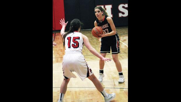 Absarokee junior Mallorey Sheppard looks to take a shot as Park City senior Brittany Frank plays defense.