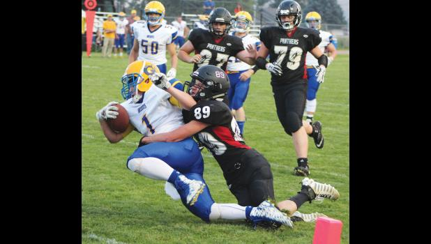 Junior Jack Bernhardt tackles a Bruin runner about one yard from the Gardiner endzone, just short of earning a safety.