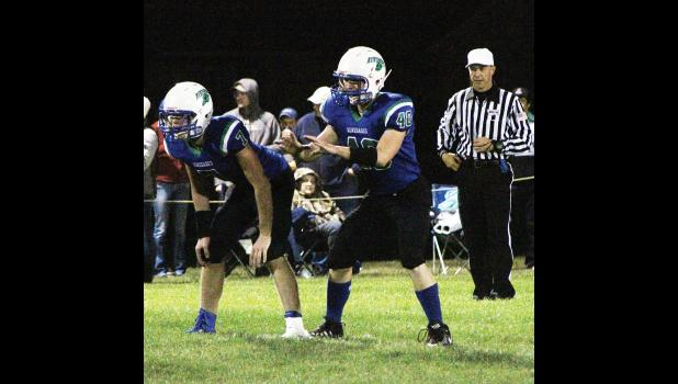 RPR junior Jeremy Boatman waits for the snap as senior Will Steinfeldt lines up next to him.