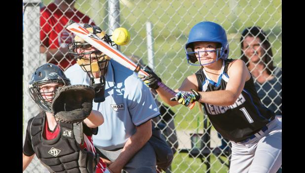 Renegade shortstop Erin Campbell attempts a bunt in the home game against the Red Devils on May 3.