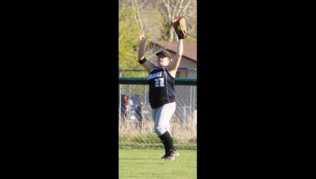 Renegade left fielder Mykaila Berry snags a long fly.