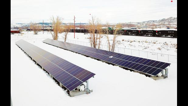 Two rows of stationary solar panels are expected to power the smelter's office building.