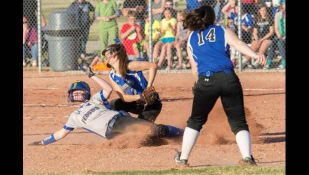 Renegade Erin Campbell tags out the Lewistown runner at second base.