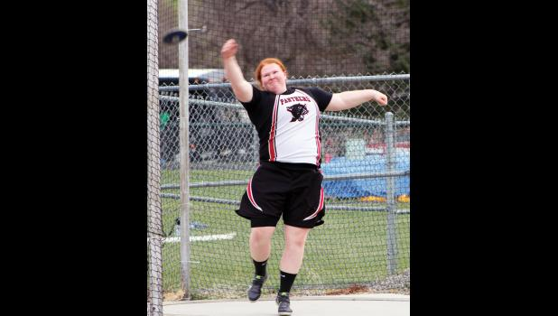 Park City senior Cara Grewell competes in the discus.