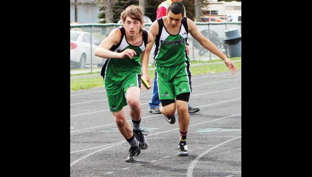 Cougar runner Connor Goddard takes the handoff from teammate Eduardo Pantoja.