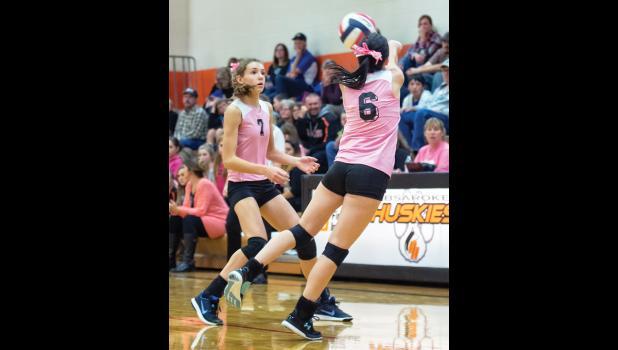RPR senior Cheyenne Gehnert makes a difficult play for the ball while freshman Carlee Blodgett backs her up.
