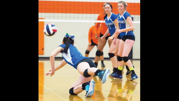RPR's Destiny Ayers (middle) and Jocelyn Ott (right) watch a teammate go for a dig.