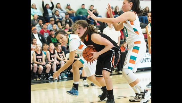 Absarokee's Rebecka Lester looks for a shot against Plenty Coups.