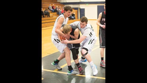 Cougars Jace Aumueller and Zach Sutton try to strip the ball.