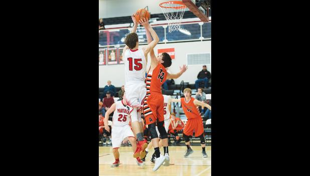 Park City's Connor McNeil is blocked by Absarokee's Joaquin Pilcher.