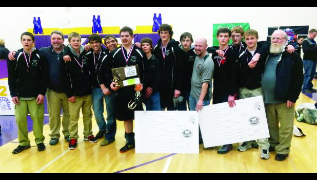 Head coach Mike Moodry, second from left, with the Columbus-Absarokee co-op wrestling team and their second-place plaque.