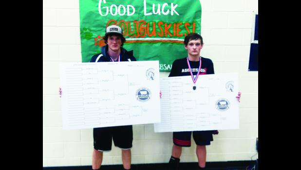 First-place Couguskie wrestlers Billy Raville, 152, and Robbie Coleman, 138, after the Southern B-C Divisional Tournament in Whitehall on Feb. 6. Both are from Absarokee.
