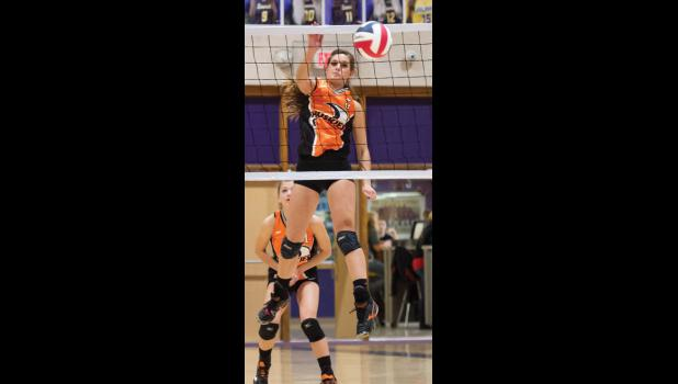 Husky senior Maissey Sheppard spikes the ball in the first round match against the Rangers.