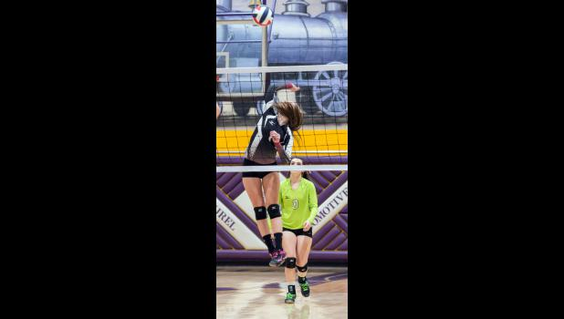 Panther junior MacKinzie Verke spikes the ball in the third round match against the Custer-Hysham Rebels while senior libero Hailee Gregerson backs her up.