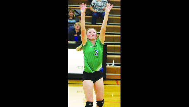 Jocelyn Ott sets the ball during Thursday's game against Absarokee.