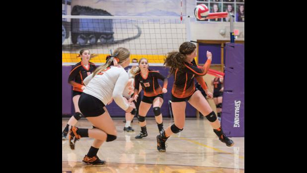 Senior Emma Chandler makes a save in Absarokee's first match against the Outlaws. Ready to assist are, left to right, seniors Colleen Culbertson, Emma LaMoure and Makayla Peterson.