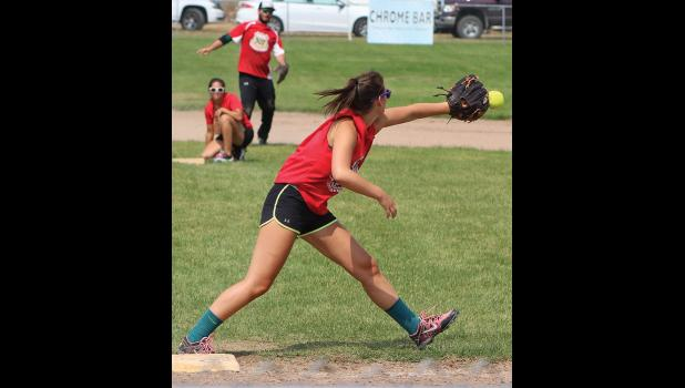 Anna Peters, of the 307 team, stretches for a ball at first base coming from the shortstop.