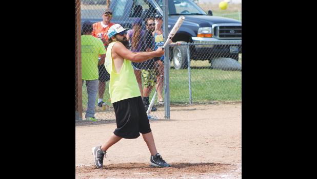 Jake Boyles, a member of Down by Two, gets a solid hit during the first day of the tournament.