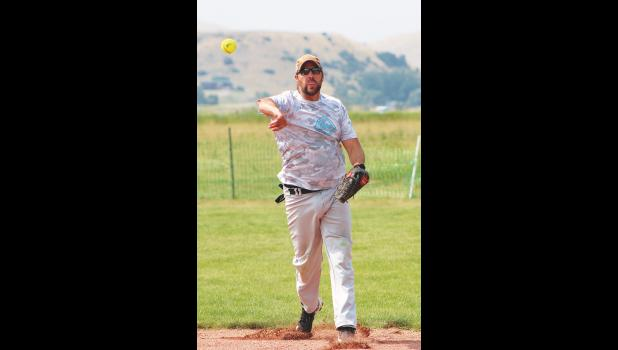 Kelly Hitchcock, Compass' shortstop and the league's president, fields a ball during the tournament.
