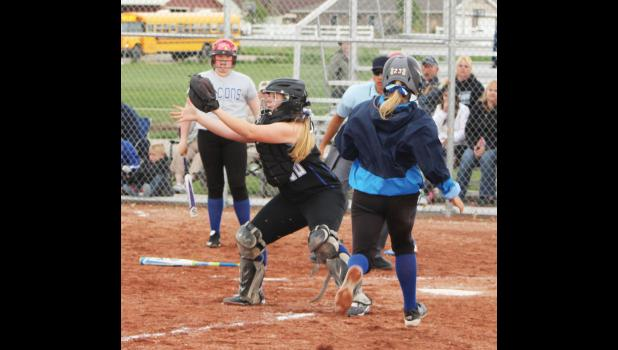 The throw from outfield made it to Renegade catcher Shelby McMillen in time to tag out the Skyview JV base runner in the May 12 home game.