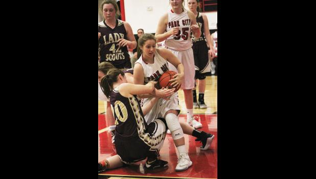 Park City sophomore Sydney Kluth wrestles the ball from a couple Bridger Scouts.