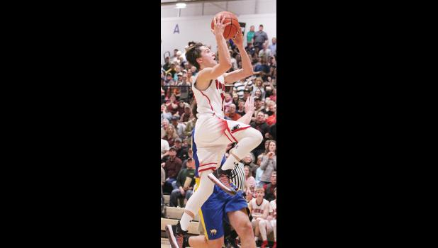 Panther senior Rylan Gauthier goes up for a basket against Melstone.