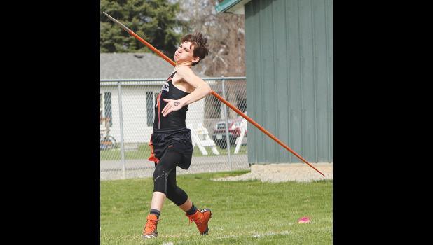 An Absarokee Huskie participates in javelin.