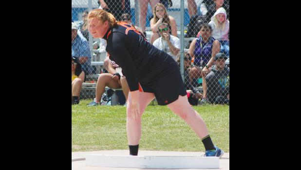 Absarokee's Katrina Feddes throws the shot put on Saturday.  Feddes finished in 15th place.
