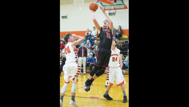 Park City senior Talon Johnstone makes a layup against Absarokee.  Johnstone had 14 points for the game.